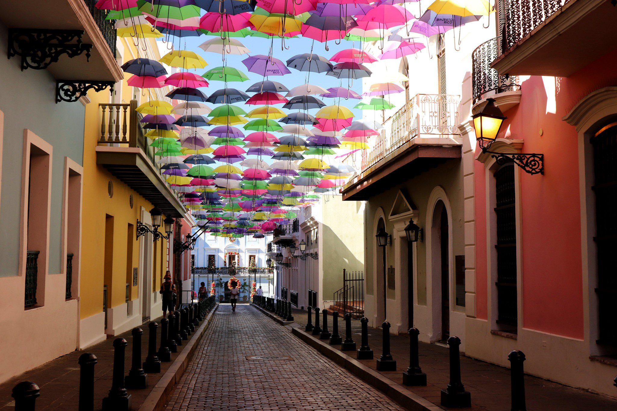 Calle Fortaleza, San Juan, Dozens of color umbrellas